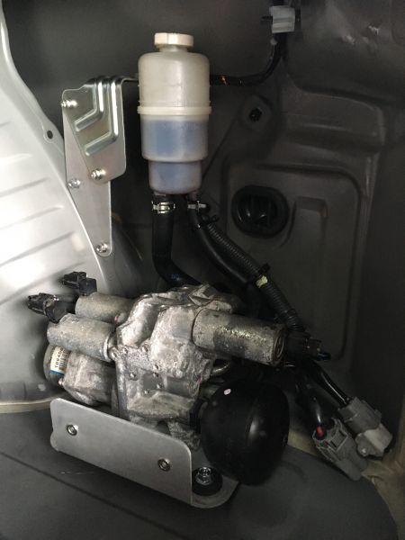 AYC-Pumpe versetzt im Kofferraum